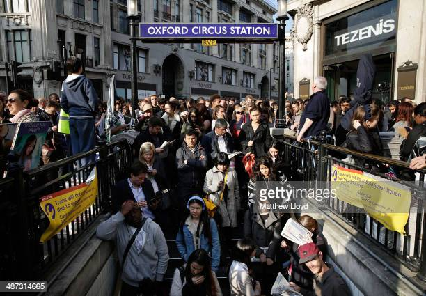Commuters are held outside Oxford Circus tube station to avoid overcrowding on April 29 2014 in London England Union members are striking for 48...