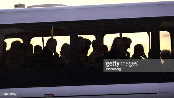 Commuters are seen silhouetted on a bus in Sydney Australia on Friday April 21 2006 Australian wages growth unexpectedly slowed in the first quarter...
