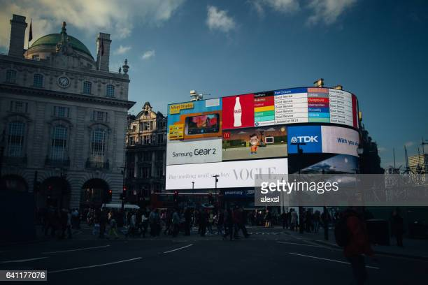 Commuters are walking in Piccadilly Circus, London