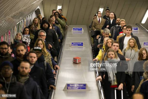 Commuters arrive at Brixton station in London on December 16 2016 Hundreds of thousands of commuters were today left stranded for the third day this...