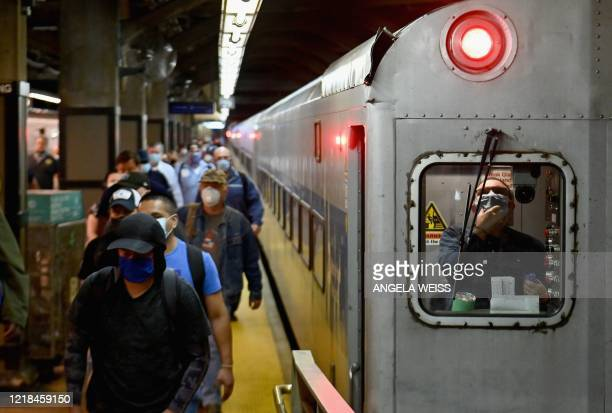 TOPSHOT Commuters arrive at Grand Central Station with MetroNorth during morning rush hour on June 8 2020 in New York City Today New York City enters...