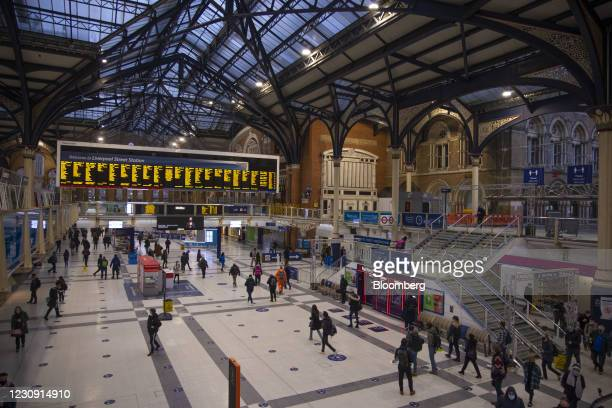 Commuters arrive at Liverpool Street railway station in the City of London, U.K., on Monday, Feb. 1, 2021. As London remodels its streets to...