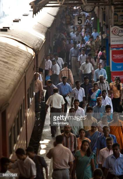 Commuters arrive at the Fort Railway Station in Colombo Sri Lanka on Wednesday March 28 2007