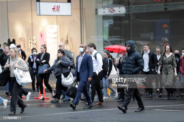Commuters arrive in the Auckland CBD on October 08, 2020 in Auckland, New Zealand. Auckland moved to COVID-19 Alert Level 1 as of 11:59pm on...