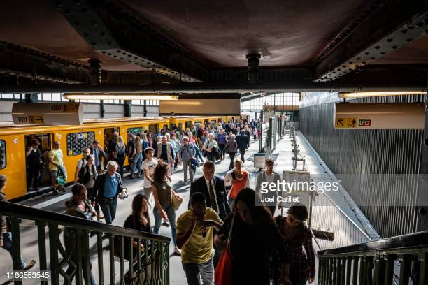 commuters at gleisdreieck station on berlin's u-bahn - u bahn stock pictures, royalty-free photos & images