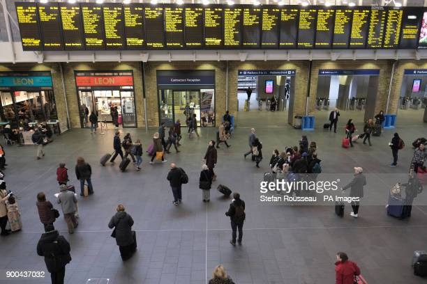 Commuters at Kings Cross Station in London, as rail passengers travelling on the first working day of 2018 are being hit with the largest fare rise...