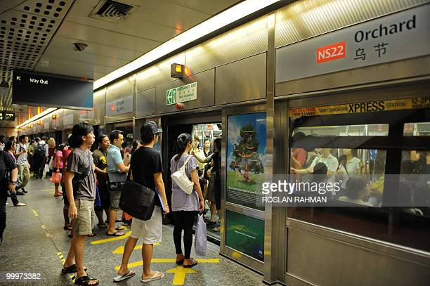 Commuters baording a train at the Orchard subway station in Singapore on May 18 2010 Local daily the Straits Times quoted a senior Indonesian police...