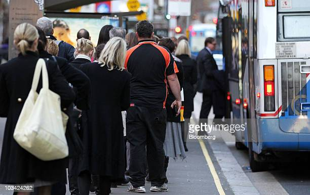 Commuters board a bus during rush hour in Sydney Australia on Monday Aug 16 2010 Sydney's transportation woes have come to underscore the debate...