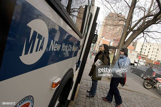 Commuters board a bus near First Avenue December 23 2005 in New York City After three days of strikes New York City subways and buses returned to...