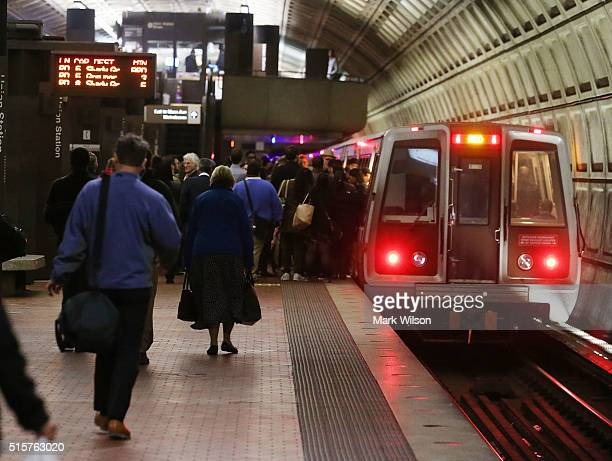 Commuters board a Metrorail train at Union Station, March 15, 2016 in Washington, DC. Metrorail announced today that they will shut down service...