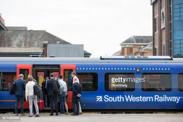 Commuters board a South Western Railway passenger train operated by Firstgroup Plc in Guildford UK on Monday June 11 2018 FirstGroup Plc the...