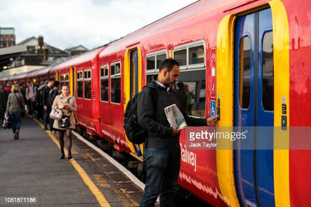 Commuters board a train at Clapham Junction Station during the morning rush hour on October 11 2018 in London England The Office of Road and Rail...
