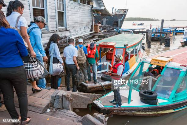 commuters board passenger boats in georgetown guyana - guyana stock pictures, royalty-free photos & images