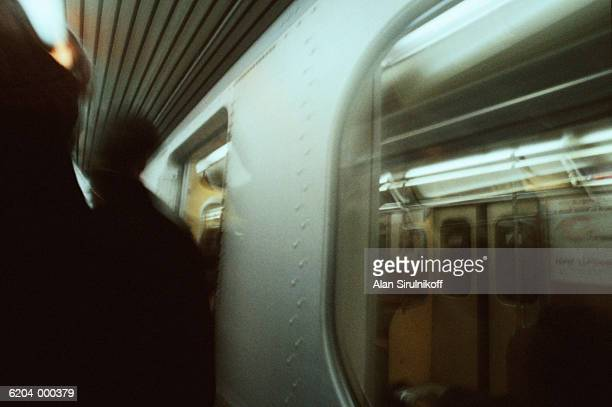 commuters board subway train - sirulnikoff stock photos and pictures