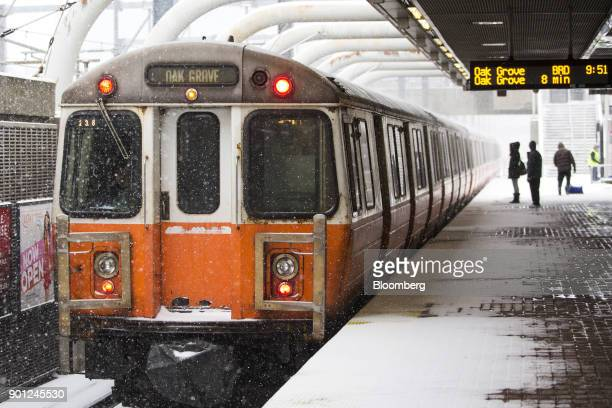 Commuters board the Massachusetts Bay Transportation Authority Massachusetts Avenue train during a snow storm in Boston Massachusetts US on Thursday...