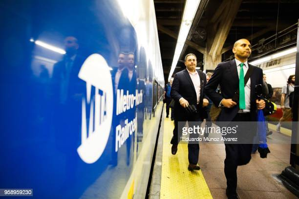 Commuters board trains as they wait for service to be restored after a severe thunderstorm downed trees that caused power outages resulting in...