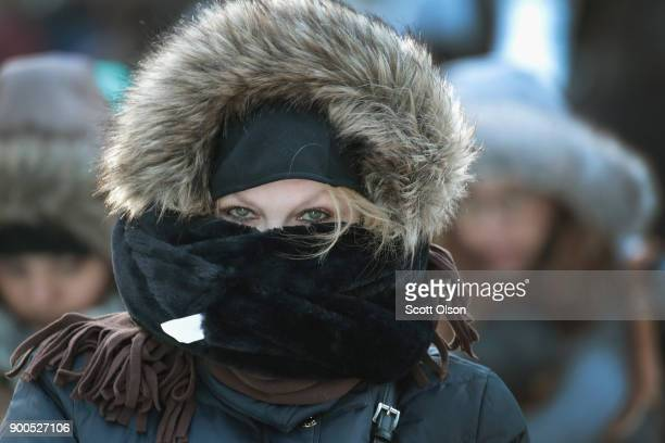 Commuters brave subzero temperatures as they make their way to work in the Loop on January 2 2018 in Chicago Illinois Record cold temperatures are...