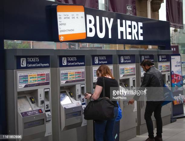 Commuters buy rail tickets at a ticket machine in Sheffield train station , in Sheffield , England , 15 August 2019. Rail users in the UK will be hit...