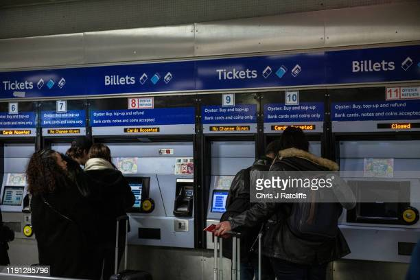 Commuters buy tickets at King's Cross underground station on January 2, 2020 in London, England. The fare increases, which were announced in...