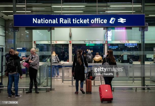 Commuters buy tickets from the ticket office at St. Pancrass train station on January 2, 2020 in London, England. The fare increases, which were...