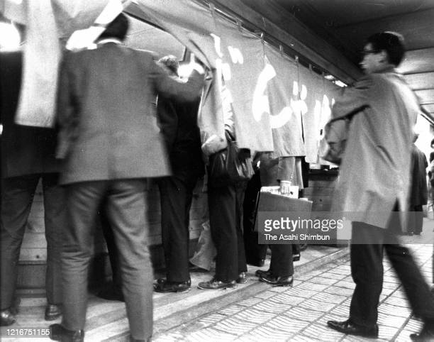 Commuters check in a standing soba noodle restaurant at an underground shopping mall of the Osaka Station on November 21, 1972 in Osaka, Japan.