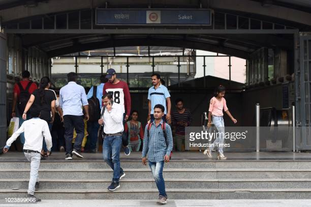 Commuters come out from Saket Metro Station after Delhi Metro Services was disrupted on August 26 2018 in New Delhi India Thousands of people...