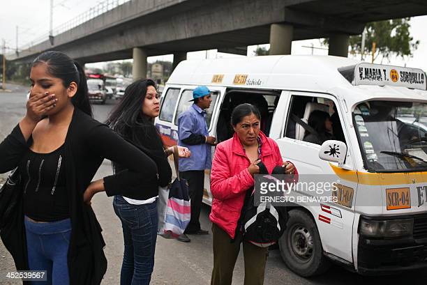 Commuters complain about pollution next to a combi minibus in Lima on November 29 2013 Lima's combis drive along the streets of Lima at high speed do...