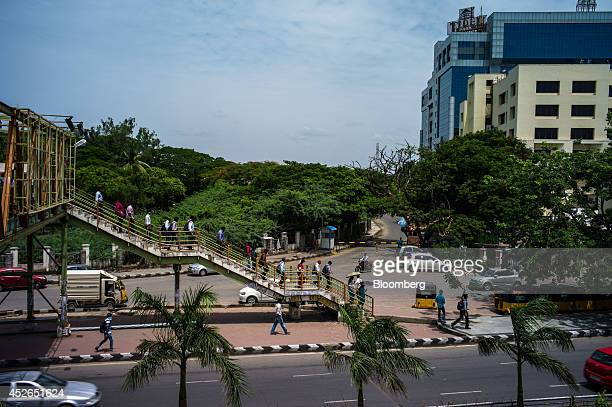 Commuters cross a bridge near the Tidel Park information technology hub in Chennai Tamil Nadu India on Monday July 21 2014 Optimism about a revival...