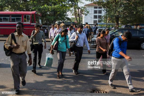 Commuters cross a road in the Fort neighborhood of Colombo Sri Lanka on Thursday April 20 2017 The Central Bank of Sri Lankais scheduled to announce...