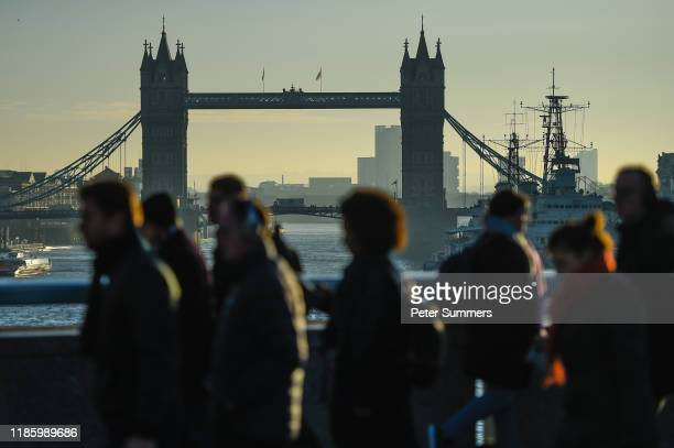 Commuters cross London Bridge, after it was reopened following the terror attack, on December 2, 2019 in London, England. Usman Khan, a 28 year old...