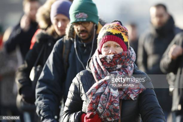 Commuters cross London Bridge after snow hit London overnight and temperatures remain below freezing on February 28, 2018. Europe remained Wednesday...