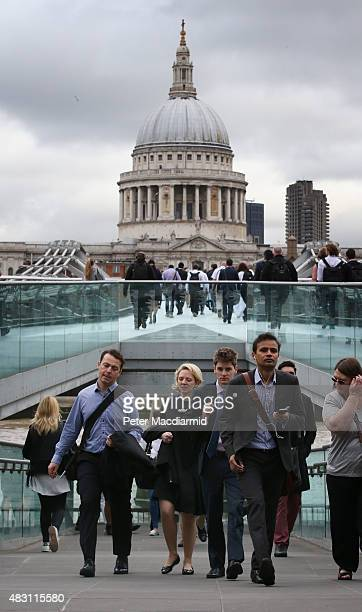 Commuters cross The Millennium bridge over the River Thames in sight of St Paul's Cathedral on August 6 2015 in London England London Underground...