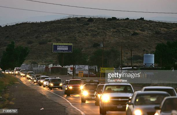 Commuters cross the San Andreas Rift Zone before sunrise as they drive toward Los Angeles on June 29 2006 near Palmdale California Scientists are...