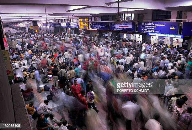 Commuters crowd a hall of a train station in downtown New Delhi on October 25 2011 According to the Indian Railways the rail system in India...