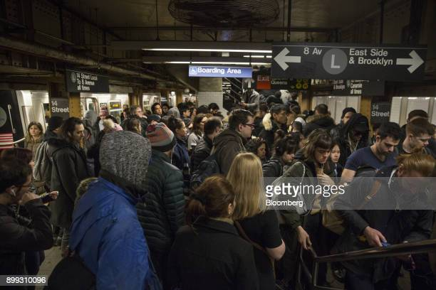 Commuters crowd onto the platform while exiting an L train at the 14th StreetUnion Square subway station in New York US on Thursday Dec 21 2017 New...