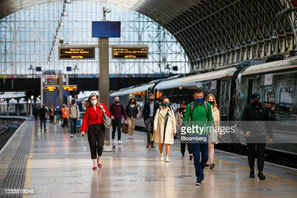 Commuters disembark a Great Western Railway train, operated by FirstGroup Plc, at London Paddington railway station in London, U.K., on Monday, July...