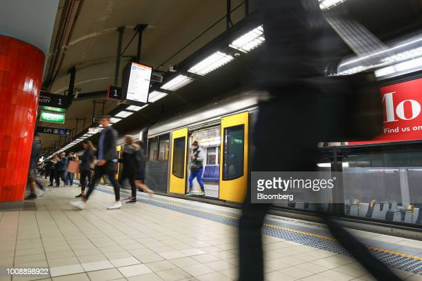 Commuters disembark a train at Bondi Junction railway station in Sydney Australia on Monday July 30 2018 The nation whose fiscal year ends on June 30...