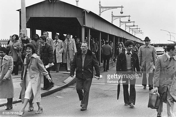 Commuters disembarking from the Staten Island Ferry during the transit strike New York City USA 2nd April 1980 The ferry is running but not the buses...