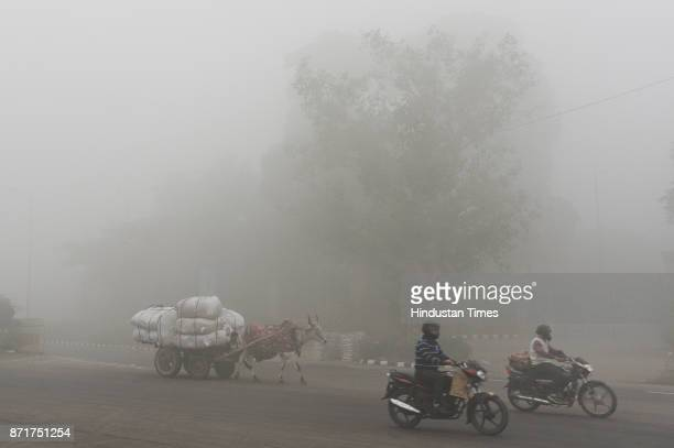 Commuters drive amid heavy smog near ITO on November 8 2017 in New Delhi India Delhis pollution levels spiked further on Wednesday as a toxic haze...