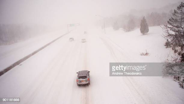 Commuters drive on the Sunrise Highway as a blizzard hits the Northeastern part of the United States on January 4 2018 in Medford New York