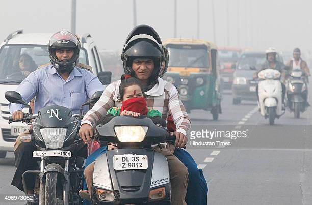Commuters drive past as roads were seen covered in smog on November 13 2015 in New Delhi India Pollution soared to hazardous levels in Delhi on the...