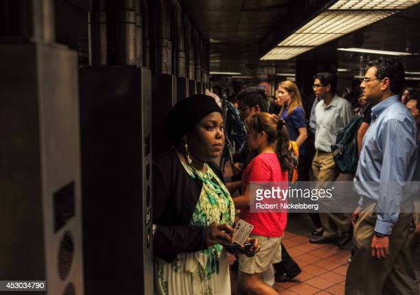 Commuters enter and exit a Metropolitan Transportation Authority subway station July 21 2014 in the Manhattan borough of New York