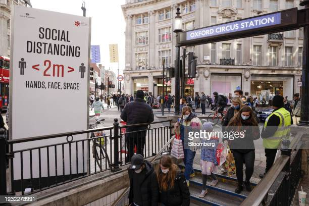 Commuters enter Oxford Circus station on Oxford Street in the early evening in London, U.K., on Monday, April 12, 2021. Consumers flocked to shopping...