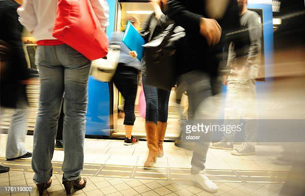 commuters entering and exiting subway train - crowded subway stock photos and pictures