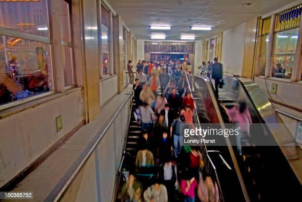 Commuters entering Chongwen  Subway Station near Main Train Station.