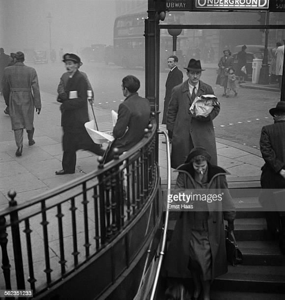 Commuters entering Piccadilly Circus tube station London circa 1953