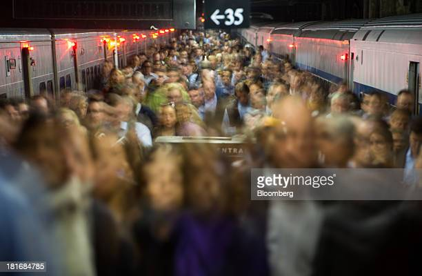Commuters exit a MetroNorth Railroad train at Grand Central Terminal in New York US on Thursday Sept 19 2013 MetroNorth Railroad a subsidiary of New...