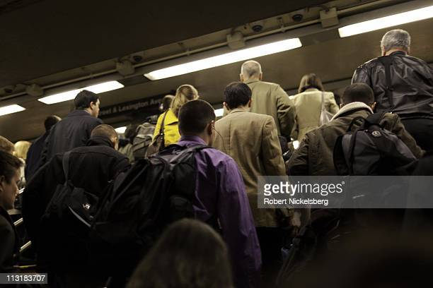 Commuters exit a subway station April 13, 2011 in New York.