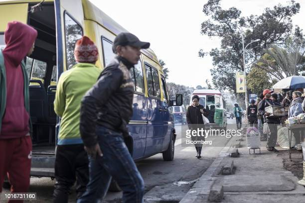 Commuters exit from a 'taxi be' mini bus in Antananarivo Madagascar on Tuesday July 24 2018 Madagascar's gross domestic product figures have steadily...