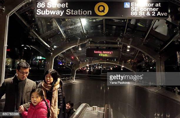 Commuters exit the 86th St Q train station on the newly opened Second Avenue subway line on January 01 2017 in New York City